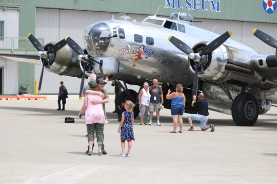Joshua Pittman, left, gives his mother a hug just after finishing his flight aboard the B-17 Yankee Lady on Saturday.