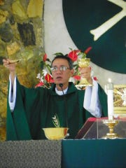 Father Vito San Andres celebrates Mass at Our Lady of Lourdes Catholic Church in Yigo in this file photo provided by the Archdiocese of Agaña. Father Vito died June 30 in the Philippines. He was 66.