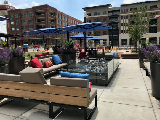 The patio furniture and firepit at Carmel's Midtown Plaza.