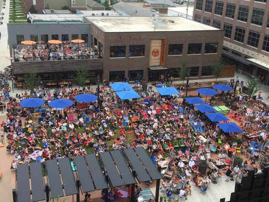 Crowds gather at Carmel's Midtown Plaza on July 7 to watch the Women's World Cup final. The plaza opened in May.
