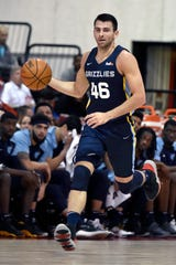 Memphis Grizzlies' John Konchar (46) brings the ball upcourt during the first half of an NBA summer league basketball game against the Indiana Pacers, Saturday, July 6, 2019, in Las Vegas. (AP Photo/David Becker)