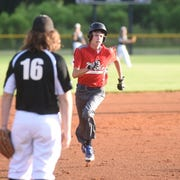 MacLeod's Payton Evans runs to third base during the team's 17-0 victory over Searcy on Saturday at Cabot.