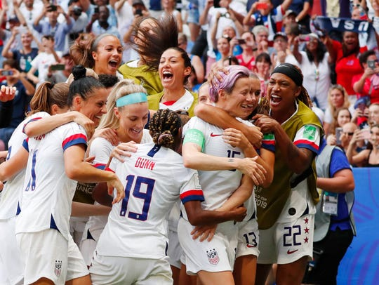 United States forward Megan Rapinoe (15) celebrates with teammates after scoring a goal on a penalty kick against the Netherlands during the second half in the championship match of the FIFA Women's World Cup France 2019 at Stade de Lyon.