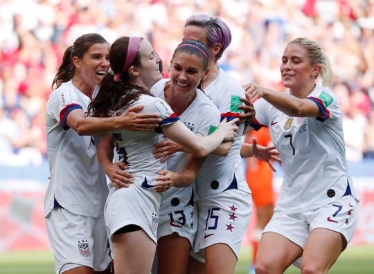 United States midfielder Rose Lavelle (16) celebrates with teammates including Tobin Heath (17) , Alex Morgan (13) , Megan Rapinoe (15) and Abby Dahlkemper (7) after scoring a goal against the Netherlands during the second half in the championship match of the FIFA Women's World Cup France 2019 at Stade de Lyon.