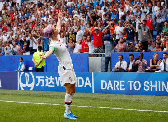 United States forward Megan Rapinoe (15) celebrates after scoring a goal on a penalty kick against the Netherlands during the second half in the championship match of the FIFA Women's World Cup France 2019 at Stade de Lyon.