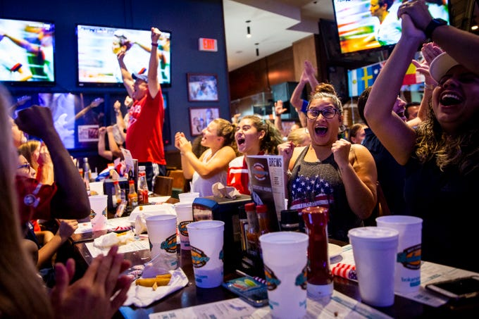 From left to right, Izzy Barrientos, 11, Alexandra Vargas, and Heylin Penate cheer after watching Megan Rapinoe successfully convert a penalty kick during a World Cup watch party at Bokamper's Sports Bar and Grill in Naples on Sunday, July 7, 2019. The United States women's national soccer team beat the Netherlands 2-0 in the FIFA Women's World Cup final.