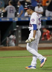New York Mets relief pitcher Edwin Diaz celebrates after a game against the Philadelphia Phillies, Saturday, July 6, 2019, in New York.