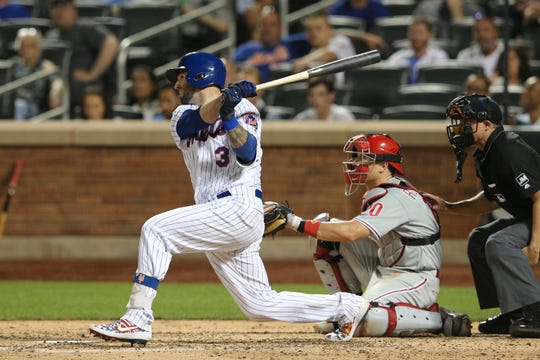 Jul 6, 2019; New York City, NY, USA; New York Mets catcher Tomas Nido (3) hits a three run double against the Philadelphia Phillies during the fifth inning at Citi Field.
