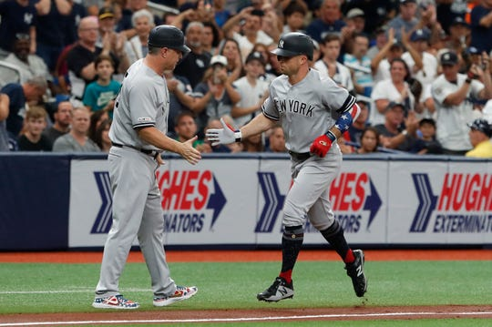 New York Yankees Brett Gardner celebrates with third base coach Phil Nevins after hitting a home run against the Tampa Bay Ray during the second inning of a baseball game Sunday July 7, 2019, in St. Petersburg, Fla. (AP Photo/Scott Audette)