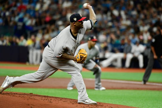 CC Sabathia #52 of the New York Yankees delivers a pitch during the first inning of a baseball game against the Tampa Bay Rays at Tropicana Field on July 06, 2019 in St. Petersburg, Florida.