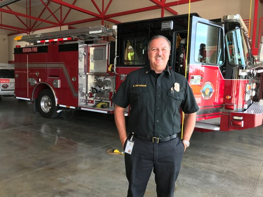 Soboba Fire Chief Glenn Patterson poses in front of a brush fire truck at the Soboba Band of Luiseno Indians' new fire station in San Jacinto on July 3, 2019.