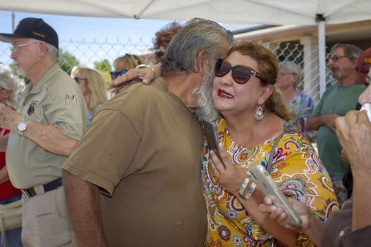 Dozens of community members gathered to celebrate Army veteran Gilbert Lopez receiving keys to his rebuilt home in Glendale, Ariz., on July 6, 2019.