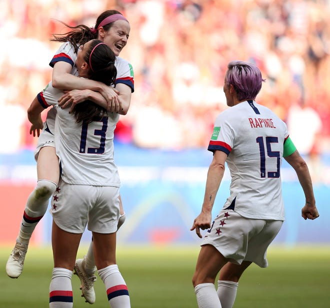 Rose Lavelle, top, celebrates with Alex Morgan and Megan Rapinoe, right, after scoring the Americans' second goal during the Women's World Cup final soccer match between US and The Netherlands at the Stade de Lyon in Decines, outside Lyon, France, Sunday, July 7, 2019. (AP Photo/Francisco Seco)