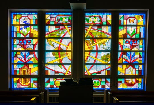 The second wave of stained-glass making at Salem United Church of Christ in Jacobus completed a panel at the rear of the sanctuary around 1993.  The wall of windows tells the story of Christ's 'I am' sayings.