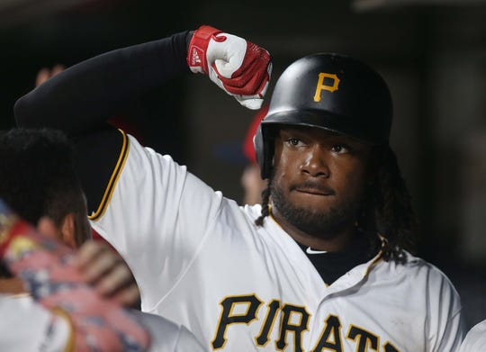 Jul 5, 2019; Pittsburgh, PA, USA;  Pittsburgh Pirates first baseman Josh Bell (55) reacts in the dugout after hitting a three run home run against the Milwaukee Brewers during the ninth inning at PNC Park. Mandatory Credit: Charles LeClaire-USA TODAY Sports