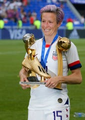 United States' Megan Rapinoe, poses with trophies as she celebrates victory in the Women's World Cup final soccer match between U.S. and The Netherlands at the Stade de Lyon in Decines, outside Lyon, France, on Sunday. The US won 2-0.