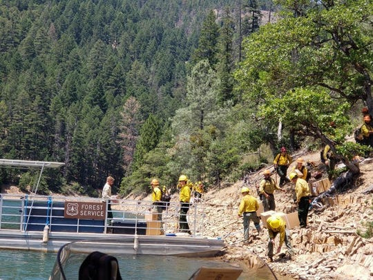 A U.S. Forest Service boat delivers supplies for firefighters battling the Captain Fire on the west side of Trinity Lake. The fire was 100% contained at 18 acres as of Friday evening, July 5, 2019.