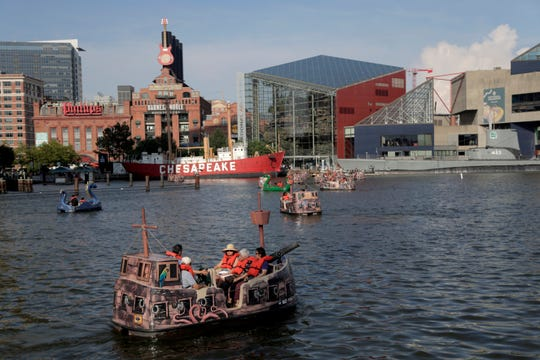 People relax on an electric boat in Baltimore's Inner Harbor, Friday, July 5, 2019. After a day of mostly sunshine, the Baltimore area is expected to see showers throughout the weekend.