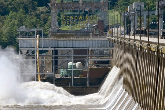 Water flows through Conowingo Dam, a hydroelectric dam spanning the lower Susquehanna River near Conowingo, Md., on Thursday, May 16, 2019. Officials once counted on the dam to block large amounts of sediment in the Susquehanna from reaching Chesapeake Bay, the nation's largest estuary, but the reservoir behind the dam has filled with sediment far sooner than expected.