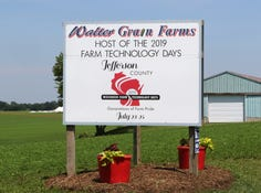 Tent city can be seen under construction behind a sign for Farm Technology Days on County A in Jefferson County on June 7.