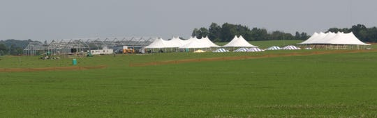 Tent city begins to take shape on June 7 at the Walter Grain Farms in Johson Creek for the Jefferson County Farm Technology Days.