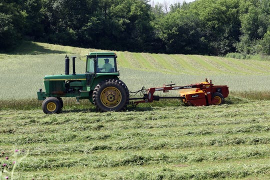 A farmer in Jefferson County cuts hay on June 7. The weather finally cooperated for making dry hay last week.