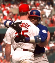 Mark McGwire gets a hug from Sammy Sosa, right, in a photo from 1998.