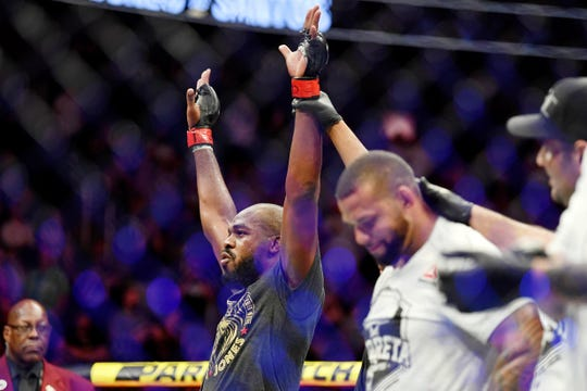 Jon Jones celebrates his win against Thiago Santos.