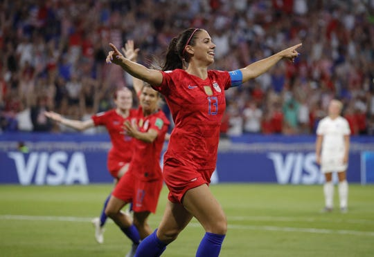 United States forward Alex Morgan celebrates after scoring a goal against England in a semifinal match of the World Cup.