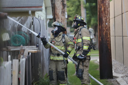 Kaukauna firefighters extinguish a garage fire in the 2400 block of Sullivan Ave. on Sunday, July 7, 2019, in Kaukauna, Wis.
