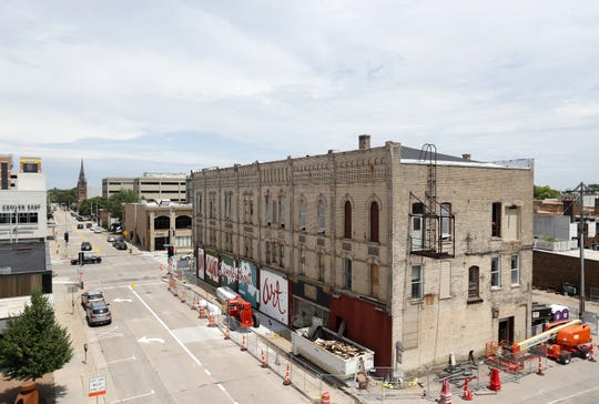 Construction equipment surrounds the Gabriel building in downtown Appleton. Here, the western face and back side.