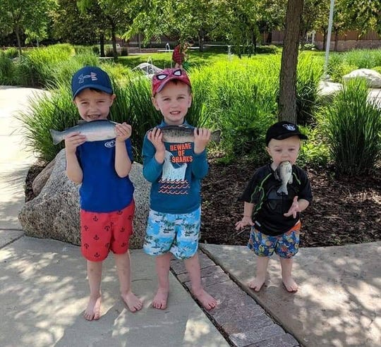 The Daniels brothers of Eau Claire pose with their fish in various ways.