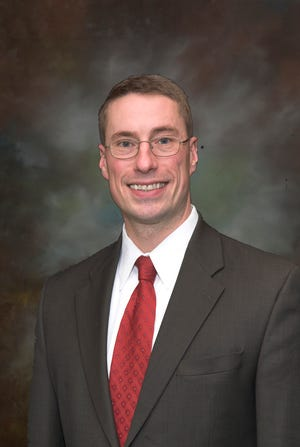 Adam Puharic, President and Owner of Puharic and Associates, Inc.