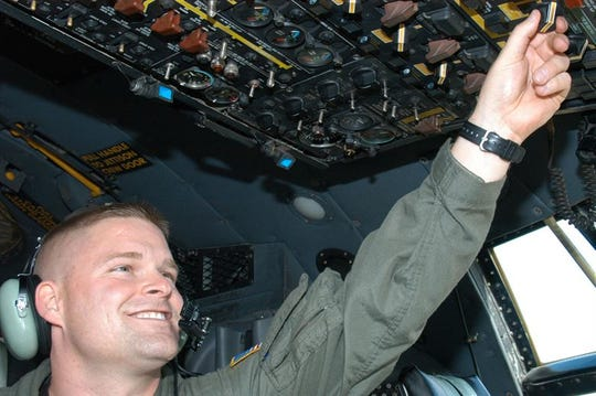 Tech. Sgt. Joey Link, 39th Airlift Squadron flight engineer, performs a pre-flight check at Dyess Air Force Base November 2006.
