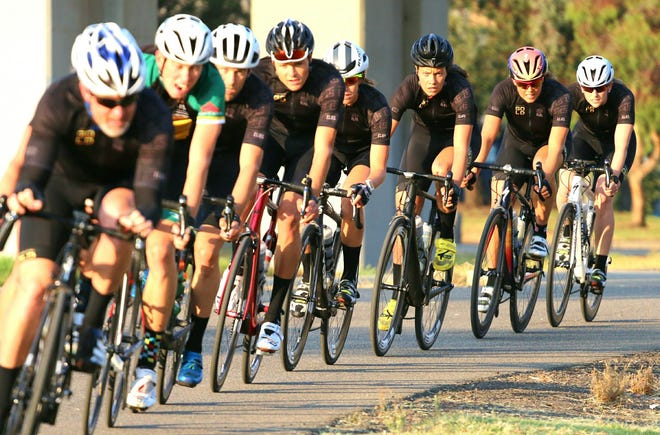 Members of the Triathlon Gold team, a group of elite triathletes training for high-level competition, relocated to Asheville in April.