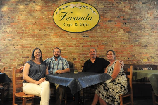 From left to right: Kathryn and Ray Nightingale and Eric and Kathy Robinson took over as owners of the Veranda Cafe & Gifts on June 5.