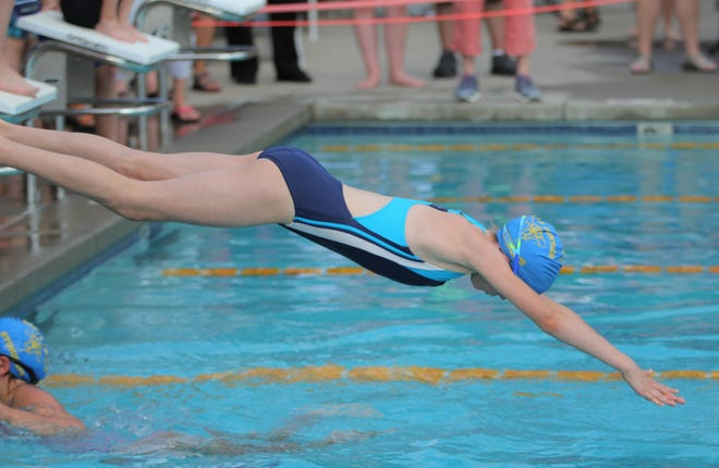 Nora Price dives into the Black Mountain pool as the Stingrays host a meet against Valdese on July 2.