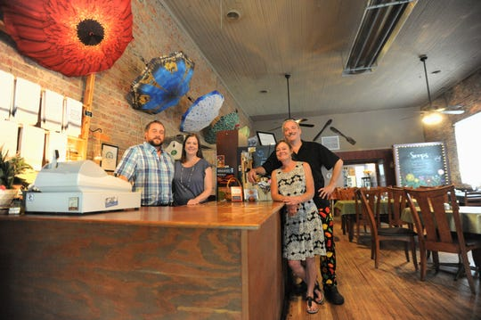 Not a lot has changed in the Veranda Cafe & Gifts on Cherry Street after new owners Ray and Kathryn Nightingale, left, and Kathy and Eric Robinson took over last month.