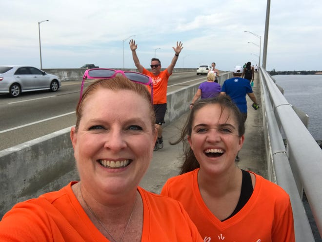 Team FLORIDA TODAY, presented by Suzy Fleming Leonard, Eliza Shaw and Rick Neale, stops for a pic at the top of the Melbourne Causeway during the July 2 stop at Hell 'n Blazes in downtown Melbourne.