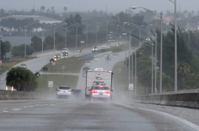 Drivers commute over the Melbourne Causeway during a storm.