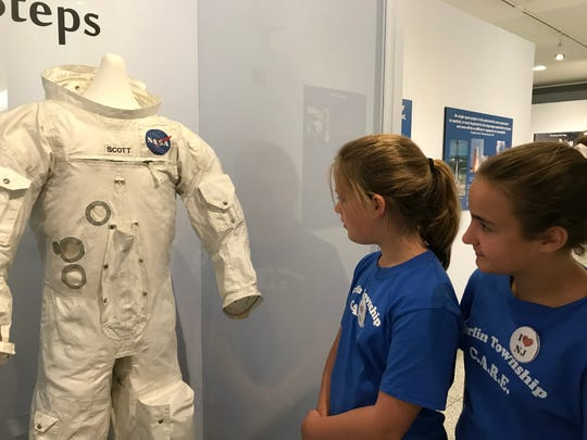 Berlin Township fifth graders Emily Whelan, left, and Ashley Shendock inspect a space suit worn by astronaut David Scott, who walked on the moon during the Apollo 15 mission. It is on loan at the New Jersey State Museum in Trenton for its current exhibit marking the 50th anniversary of Apollo 11, which put the first man on the moon.