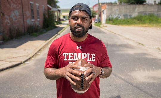 Fran Brown, a Camden native who became one of the best college football recruiters in the country and is now the co-defensive coordinator and cornerbacks coach at Temple University, stands on Morton Street as his revisits the Camden neighborhood where he grew up.