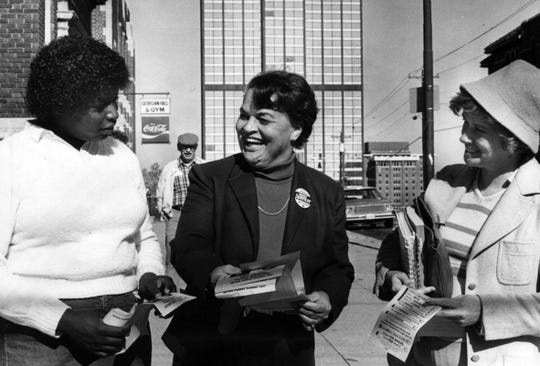 NOVEMBER 9, 1983: Tuesday was a big day for female city council candidates in Cincinnati. Marian Spencer hands out campaign literature at Calhoun and Scioto Streets to Lisa Ford, left, and Caroleen Lewis.