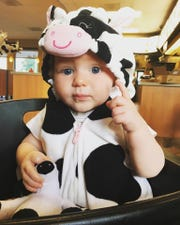 Even babies dress like a cow on Cow Appreciation Day. Chick-fil-A's 15th annual celebration on July 9 is a thank you to customers.