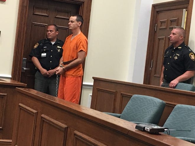 A shackled Michael Andrew Clark, a technical sergeant in the US Air Force, makes his first court appearance in Clermont County Municipal Court.