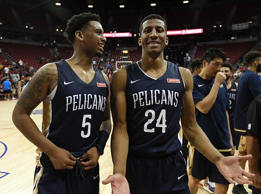 Trevon Bluiett #5 and Aubrey Dawkins #24 of the New Orleans Pelicans walk off the court after their game against the Washington Wizards during the 2019 NBA Summer League at the Thomas & Mack Center on July 6, 2019 in Las Vegas, Nevada.
