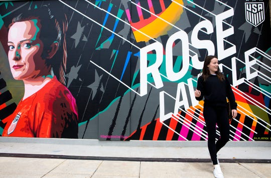 May 21, 2019: Rose Lavelle, United States Women's National Soccer player and Cincinnati native, reacts to seeing a mural of herself put up on a wall on West Freedom Way in Downtown Cincinnati.