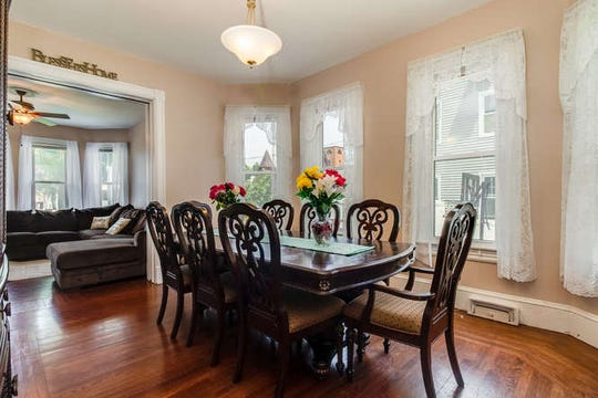 Located on a tree-lined street in a neighborhood, a vintage Colonial in Bound Brook Borough that is situated safely out of the flood zone is for sale for $299,900.