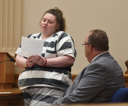 Mackenzie Knigge, 28, reads a statement during her sentencing hearing on Monday, July 8, 2019, at the Webster County Courthouse.