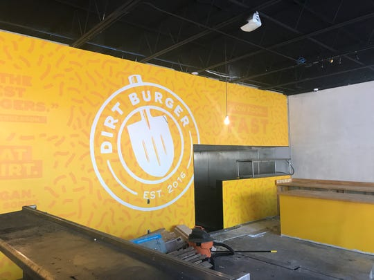 Adam Feller, a graphic designer and marketer with Avidity Creative designed the logo, painting the wall with help of an intern from Iowa State. Friend and carpenter, Tyler Pollin, built the countertops.